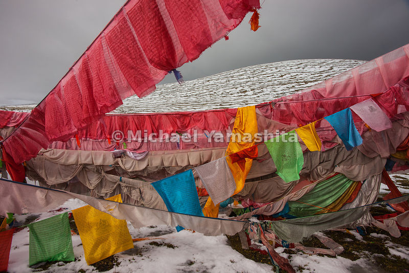 "Tibetans call these multi-colored flags ""wing horses."" They are hung to protect travelers crossing through the often-treacher..."