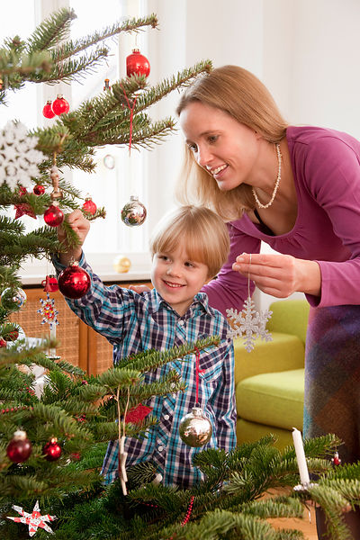 mother, son decorating christmas tree