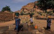 women collecting water from the village well, Songo, Dogon Country, Mali