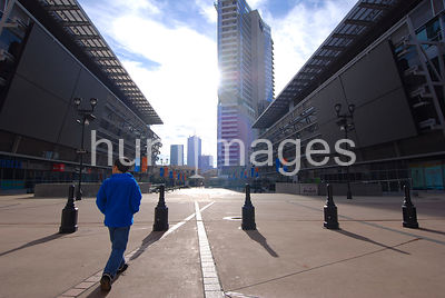 Boy walking into the sunlight in downtown Dallas