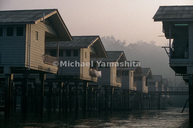 "Kampong Ayer - ""Water Town"". Residents here asked to resettle in a new water village after a fire destroyed the port. Kampong..."
