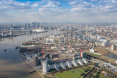 Aerial view of London, River Thames at Silvertown towards Docklands.