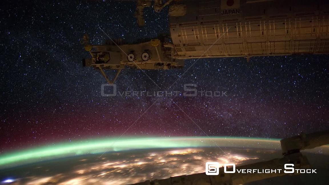 Time-Lapse from ISS over  Milky Way Aurora Borealis 23 Jan 2012