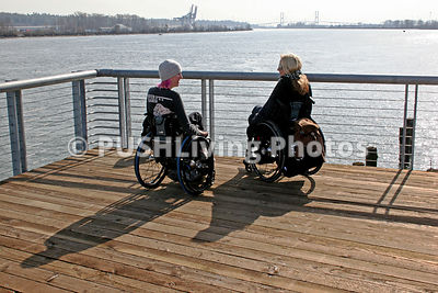 Two women in wheelchairs enjoying a day out in Vancouver