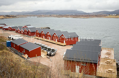 New development of traditional red houses on the edge of the sea