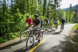 May 22, 2015: Whistler BC. Cyclists cycle along the Valley Trail on a sunny summer day. Photo by James Cattanach - coastphoto.com