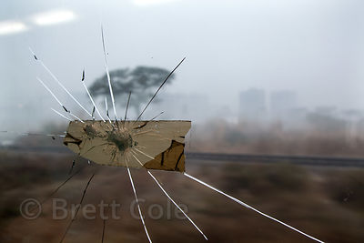 Broken window on a train in Delhi, India