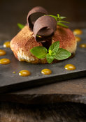 Furca.Beignet chocolate, Passionfruit coulis, mint.