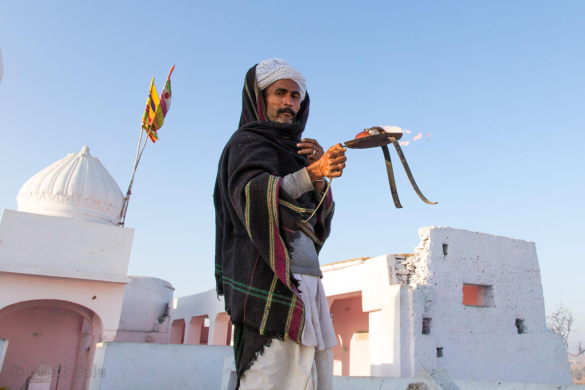 A man offers morning prayers at a temple in Bhagwanpura village, Rajasthan, India