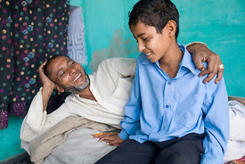 Musarif Ahmad, 10 and his father, Farmana