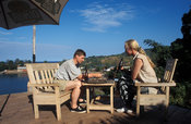 tourists sitting in a bar overlooking the lake, Nkhata Bay, Lake Malawi, Malawi