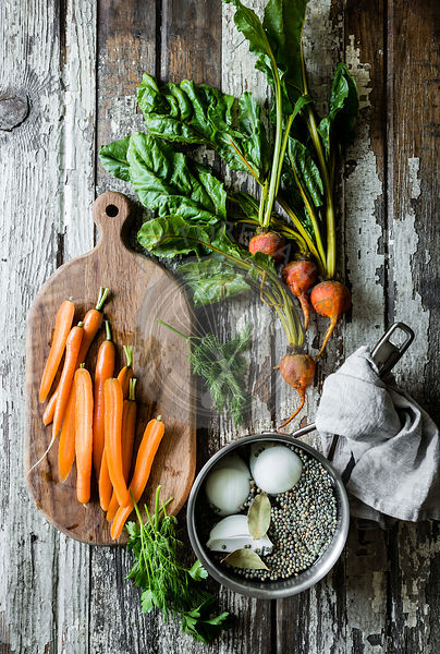 Carrots, beets and lentils on a vintage wooden table background
