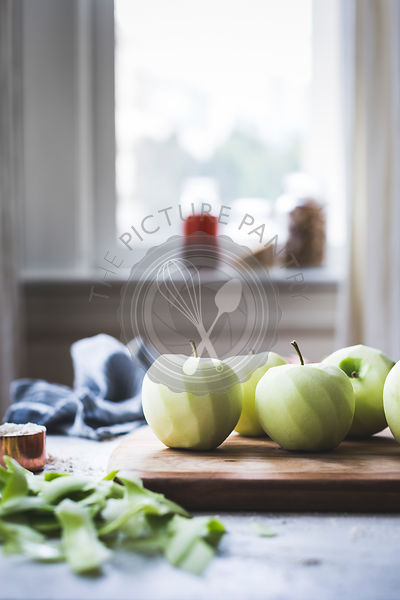 Fresh peeled apples on a chopping board