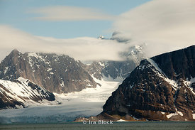 A mountain in the Hornsund fjord trapped by ice from the previous winter.