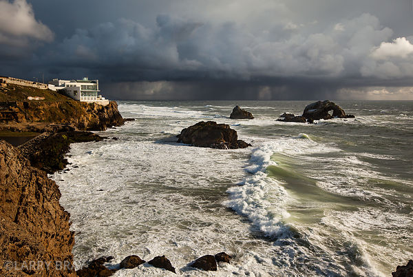 Wide view of The Cliff House with dramatic stormy skies in San Francisco, USA
