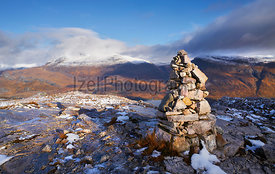 A mountain Cairn on Beinn Eighe with the summits of Slioch and Beinn a Mhuinidh in the distance. Scottish Highlands, Scotland...
