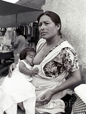 serene nursing mother in Merida market