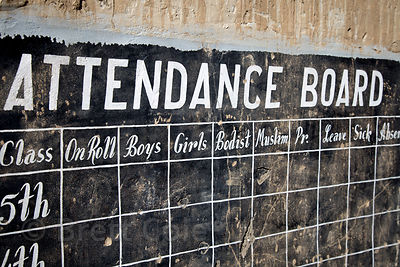 "Attendance board at an abandoned elementary school in Saboo village, Ladakh, India, with labels reading ""Boys, Girls, Bodist,..."