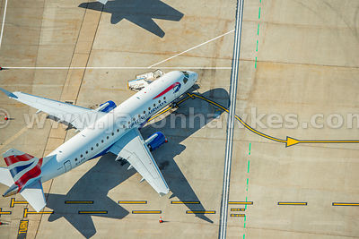 Aerial view of British Airways ( BA ) plane at City airport, London