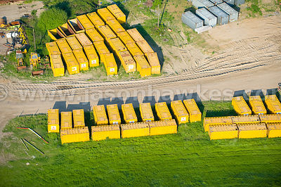 Yellow shipping containers at Mucking Marshes Landfill site