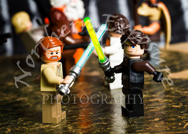Lego Star Wars figures of Obi Wan Kenobi dueling with Anakin Skywalker