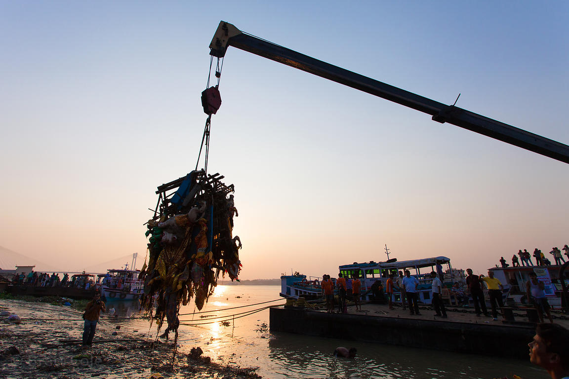 Idols are pulled from the Hooghly River with a crane during the Durga Puja festival, Kolkata, India. The idols are immersed b...
