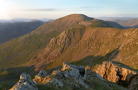 Sunset over Ennerdale from Scoat Fell with views of Pillar In the English Lake District, UK.