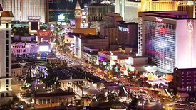 Bird's Eye: A Close Up View Above Heavy Traffic, Projections, & The Lights Of The Strip