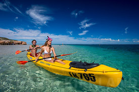 Couple paddling off Coral Bay, Western Australia