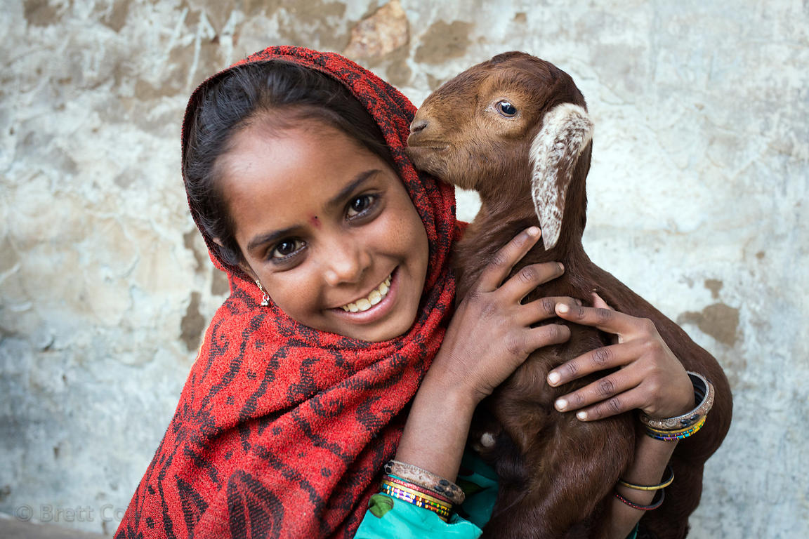 A girl with her baby goat in Kharekhari village, Pushkar, Rajasthan, India