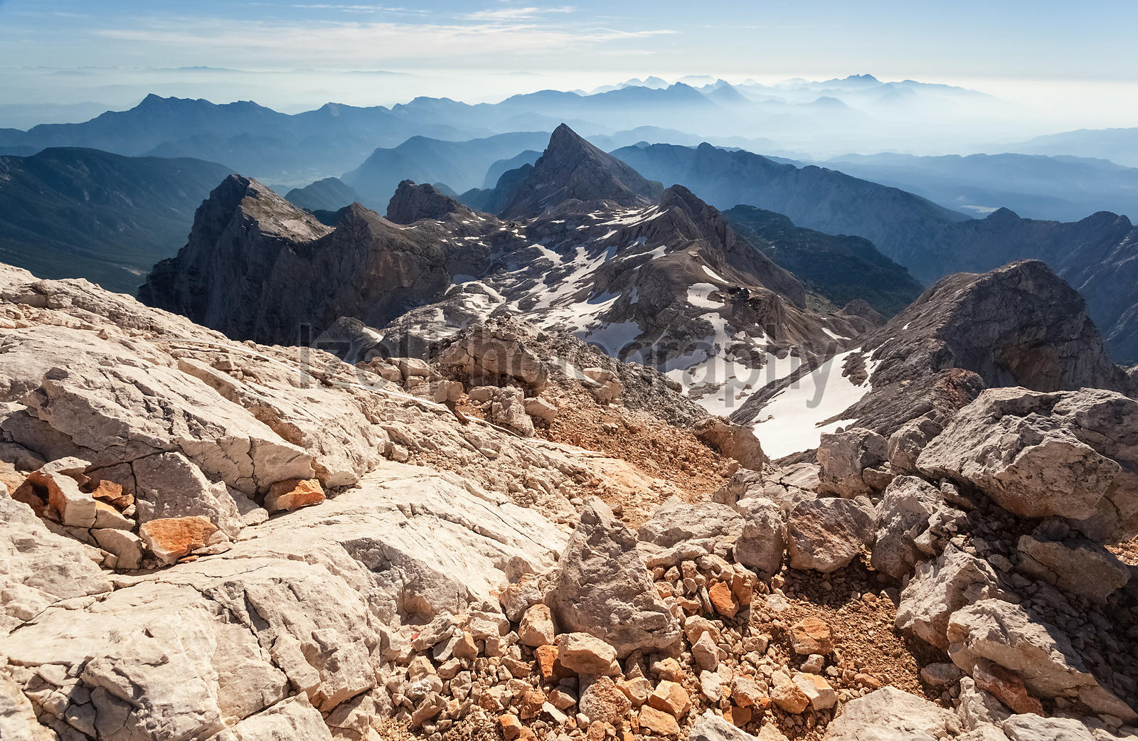 Looking down the ridge that leads to the summit of Triglav with the mountain hut in the distance.
