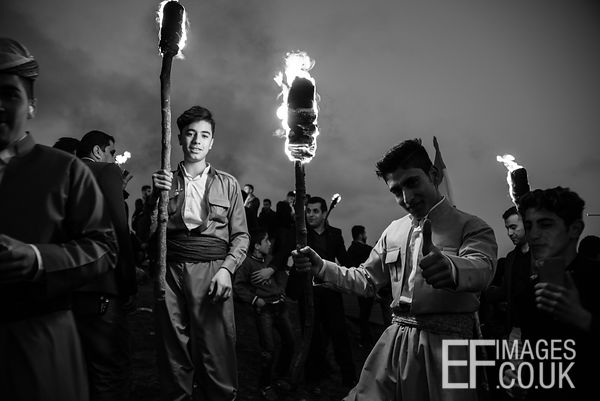 Kurdish Boys Carrying Burning Newroz Torches