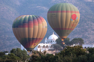 Tourist hot air balloons float past the Gulab Niwas hotel in Pushkar, India.