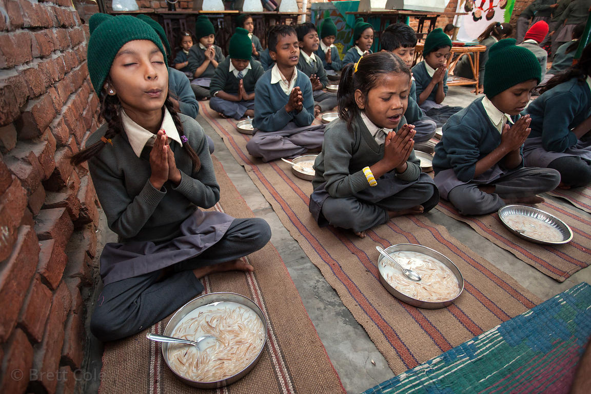 Students pray before eating at a school in Varanasi, India operated by Dutch NGO Duniya (duniya.org)