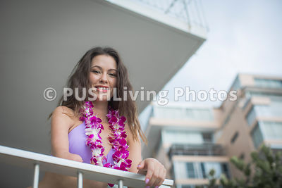 Young woman in a bikini on her apartment balcony
