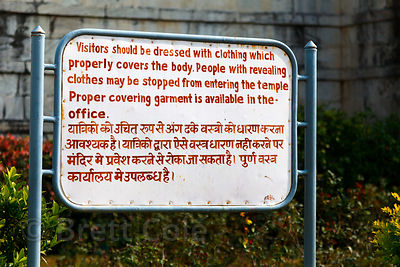 Sign informing visitors that they must wear modest clothing, Ranakpur Jain temple, Rajasthan, India