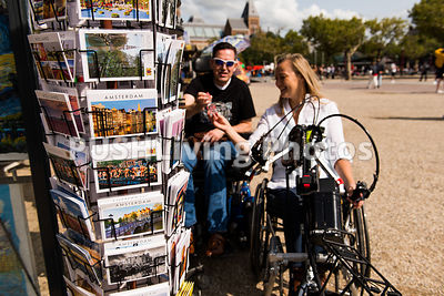 Couple using power buying souvenirs