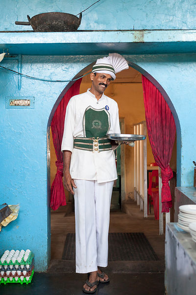 India - Kollam - Sangaran, a waiter who has worked at the coffee shop for 17 years. The Indian Coffee House