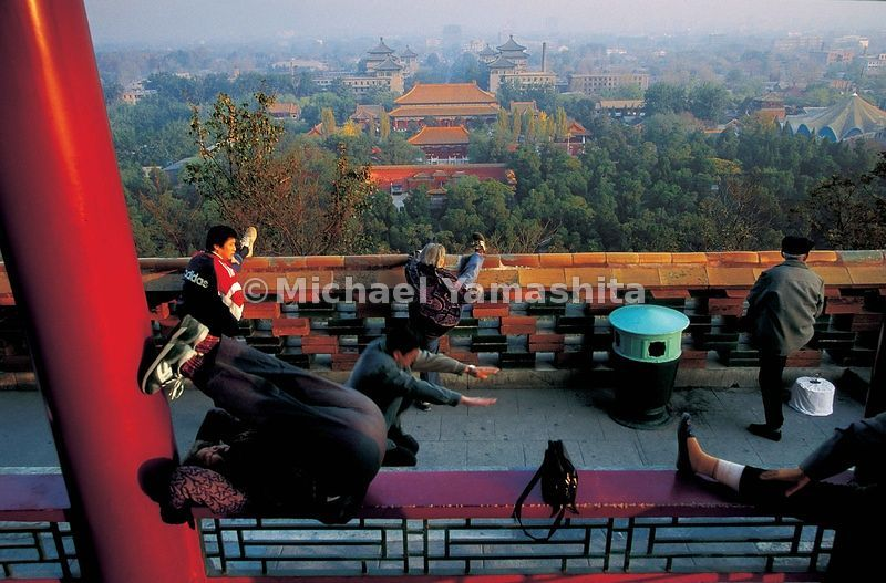 Early morning exercise atop Coal Hill, the highest point in Beijing, said to be built on the ruins of the Mongols' palace.