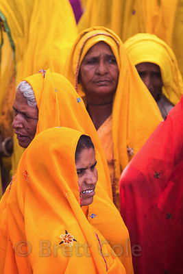 Ladies in mostly yellow saris mark a day (I can't remember the name of it) where they all gather and cry loudly to mourn dece...