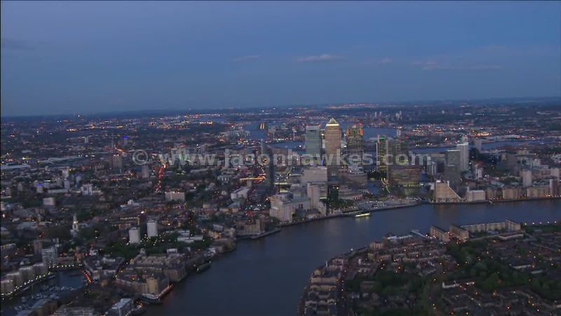 Aerial footage over Canary Wharf at dusk, Isle of Dogs, London, England, UK