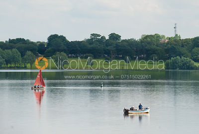 Sailing boat and fishermen on Rutland Water