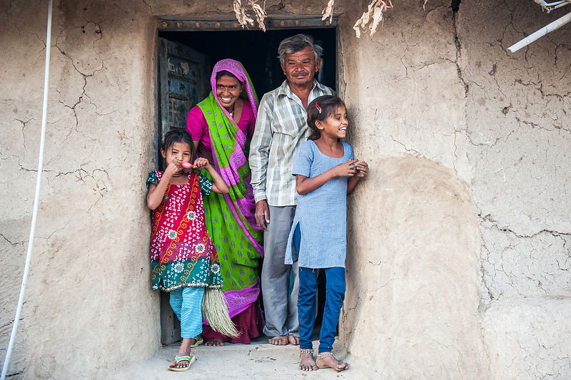 A family of four walk out of their house in the morning in a village in Bhuj, Gujarat