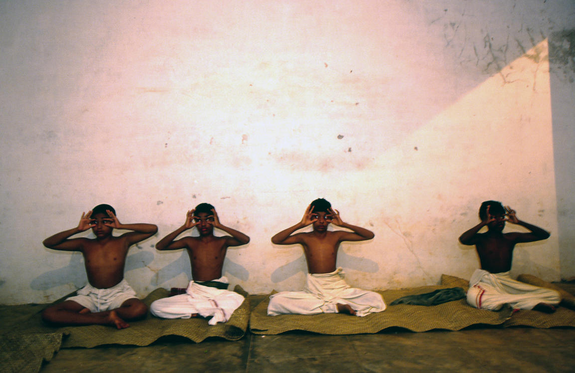 India - Kerala - Boys practice eye exercises at dawn in a class at the Keralan Kalamandalam.