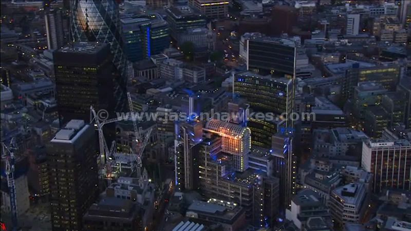 Aerial footage over the City of London at night, England, UK