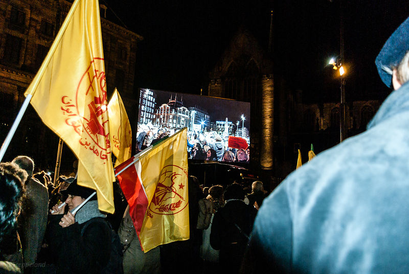 Amsterdam, Netherlands 2015-01-08: A media report is projected on large screens during the protest rally: 'Je suis Charlie'.