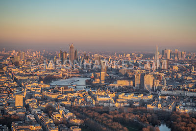Sunset over Whitehall, aerial view, with Southbank and City of London, London.