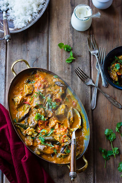 Aubergine curry with coriander in a serving dish