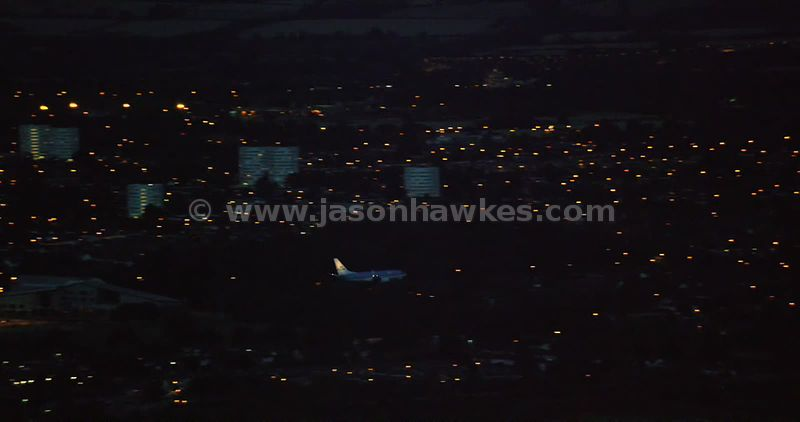 Aerial footage of an aeroplane landing at Birmingham airport