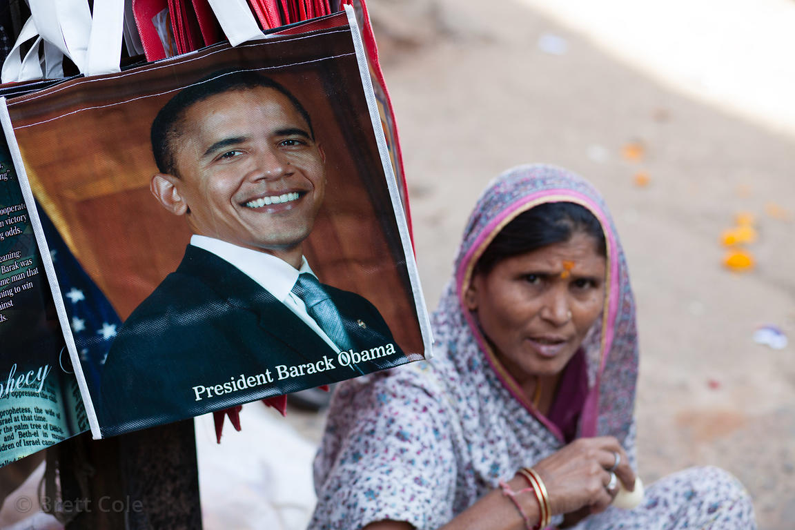 A woman sells shopping bags with a picture of US President Obama on them at a market in Pushkar, Rajasthan, India.